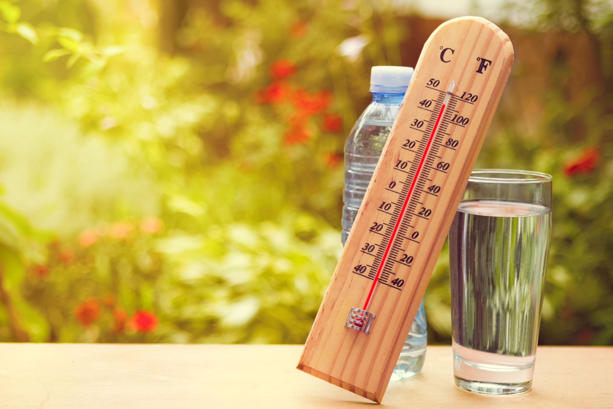 Thermometer showing over 100 degrees with drinking water