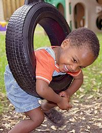 Child Playing with Tire Swing
